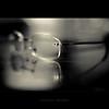 G (alvin lamucho ©) Tags: light bw reflection monochrome dark table photography 50mm glasses lowlight dof desk bokeh f14 monotone gucci vision workplace kuwait shallow lowkey depth eyeglass bethoumyvision alvinlamucho