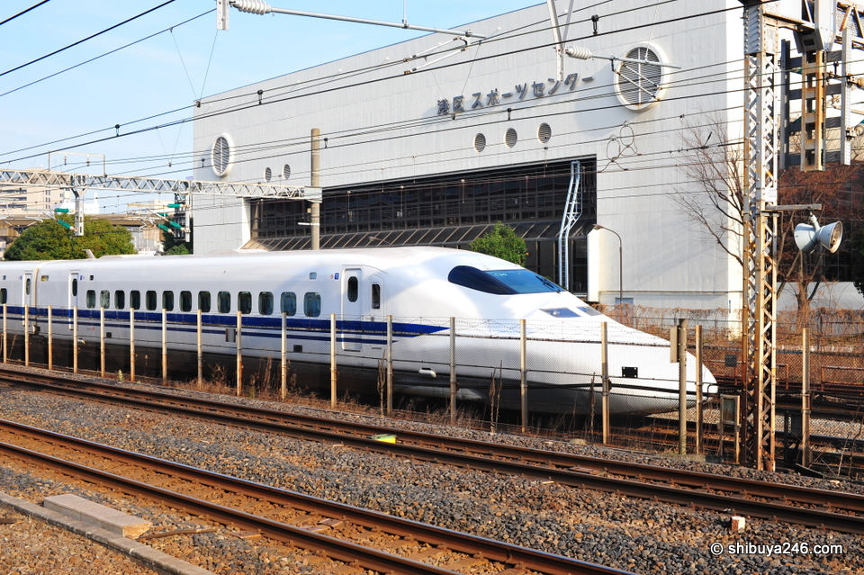 Shinkansen passes by the Minatoku sports center.