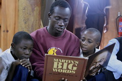 Jackson reads Martin's Big Words aloud (Lubuto Library Partners) Tags: lubutolibraryproject zambia lubuto library libraries africa books ovc literacy aids hivaids orphans children youth education reading streetchildren streetkid fountainofhope lusaka martinsbigwords lubutolibraries lubutolibrarypartners publiclibraries ovcy