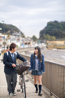 High school student couple walking together to school