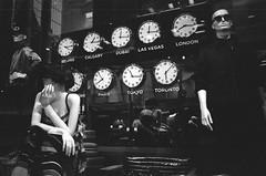 It Was More Like 4pm (Georgie_grrl) Tags: mannequins windowdisplay thebay pentaxk1000 rikenon12828mm toronto ontario blackandwhite monochrome jchstreetpan400 clocks timezones alittleoff itwasabout4pmintorontowhenishotthis morelikebeijingtimeaccordingtothiswindowdisplay explore