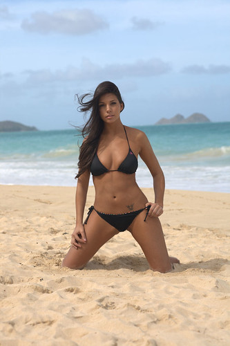 American model Michelle Lummus posing in bikini on beach