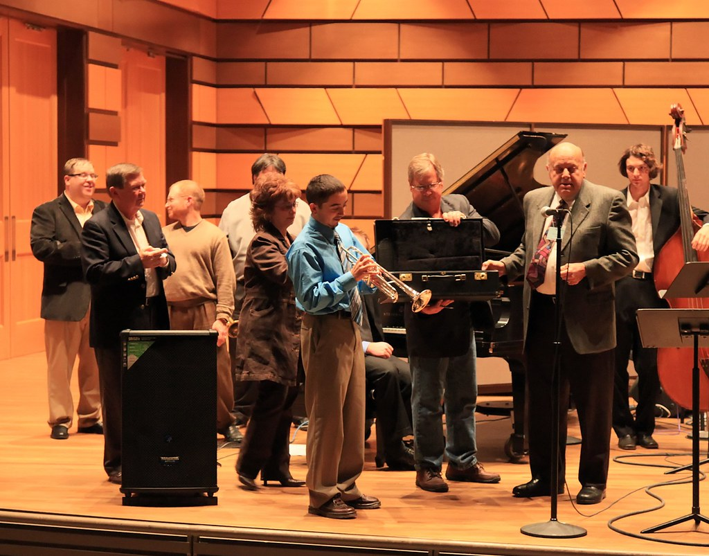 Anthony Delgado accepting his Getzen Proteus trumpet from Harold Stone of Getzen.