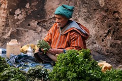 Moroccan Street Seller (Alex E. Proimos) Tags: street vegetables hat photo market islam traditional hard culture morocco buy tradition sell seller complain complained proimos alexproimos