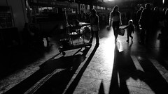 Chasing light [4] (Che-burashka) Tags: street light boy people urban bw sun sunlight london love parenthood monochrome station childhood blackwhite shadows child mother silhouettes bn negativespace trainstation backlit cleaner euston londonist chasinglight silhhouette lx3 studyinglight urbanlyric