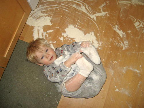 Jacob spilled flour and rolled in it