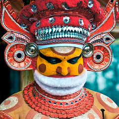 Mutthapan as Lord Vishnu (christian.senger) Tags: travel red portrait people india man face yellow digital geotagged eyes nikon worship asia dof religion kerala hinduism lightroom d300 theyyam kannur muthappan christian_senger:year=2010