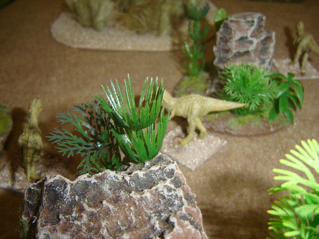 Carnosaurs move through jungle