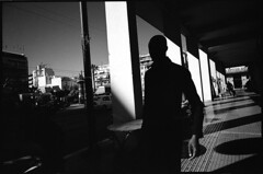 ATHENS OUT (Kiriakos Korakis (korax67)) Tags: street city shadow bw man square photography europe running athens greece ilfordxp2 21mm contaxg2 orangefilter biogon ilfordxp2400super biogon2821 amerikis plateiaamerikis  kiriakoskorakis kyriakoskorakis korax67