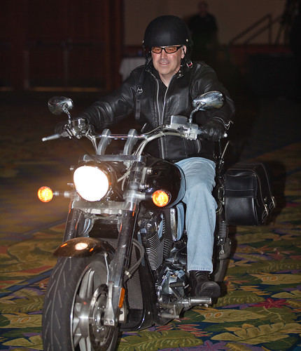 Doug Rides his Harley Davidson on Stage During the Speech