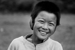 Radiant smile (Koyaanisquatsi) Tags: travel boy portrait mountains tourism nature beauty smile trek happy shy headshot lad local himalayas sikkim