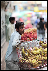 Nepal, Kathmandu (Dietmar Temps) Tags: street nepal portrait people colors market bokeh streetlife bananas kathmandu selling f12