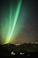 Flare (LalliSig) Tags: winter sky orange cloud mountain snow mountains green yellow rock night dark stars landscape star iceland rocks nightscape aurora borealis