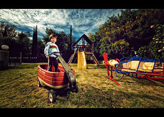King of the Yard (isayx3) Tags: light boy portrait sun clouds yard umbrella wagon one backyard nikon shoot sigma noon 365 f28 d3 43 strobe thru onelight 14mm pocketwizard strobist ab1600 plainjoe isayx3