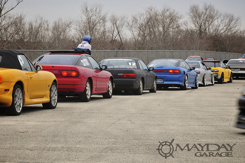 A group of drift cars look like a spilled bag of skittles.