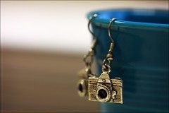 hangin' around (helen sotiriadis) Tags: camera blue macro cup closeup canon silver published dof bokeh jewelry depthoffield earrings canonef100mmf28macrousm canoneos40d digitalslrphotographymagazine toomanytribbles updatecollection extremephotographyobsession boughtthematwwwshanalogiccom