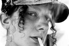 192/365: I Am Ahab (joyjwaller) Tags: portrait blackandwhite girl face hat japan tokyo cigarette smoke smirk project365 iwasoncetaughthowtodriveaboatbutmylessonwasseriouslycancelledwhenisteeredustotherapids theseeyesknowmorethantheysayin wierdlittlewillsmithears
