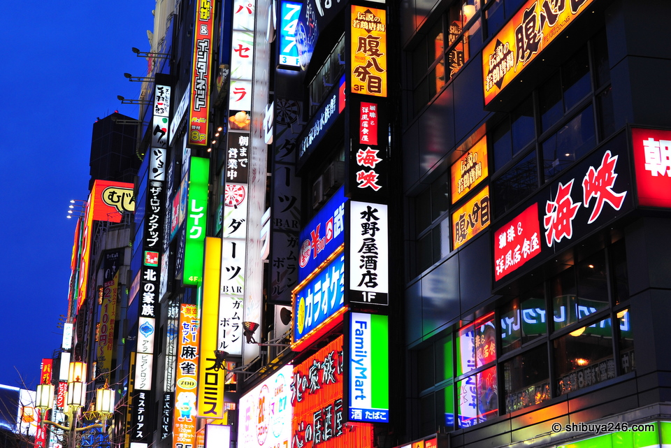 The Shinjuku neon glows bright.