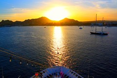 Explotion of light.. (David Fitzgerald3) Tags: ocean travel cruise carnival light sunset sea vacation sky sun seascape mountains reflection beach nature water sunshine clouds skyscape landscape mexico coast boat canal haze cabo scenery rocks skies sailing ship arch pacific silhouettes mexican layers rays traveling elation beams cabosanlucas seaofcortez loscabos riveria explotion mywinners davidfitzgerald cannoneosrebelxs