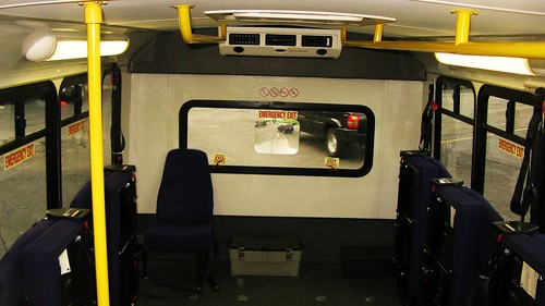 Interior view of First Transit Ford paratransit bus # 5390. Seen here with the side seats folded up to accomodate wheelchairs. by Eddie from Chicago