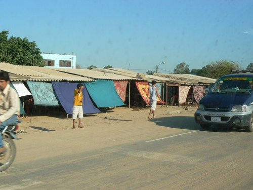 More market. Those rugs and tarps are there to block the hot, afternoon sun.
