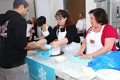Snow_Day_team_draping_cake_in_fondant