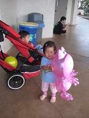 Aki with her loot (yellow ball and pink frog)