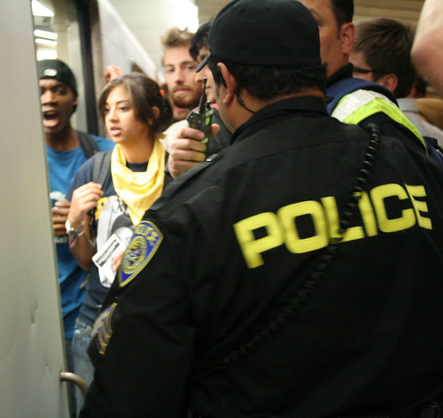 Police moves in on protesters inside BART doorway