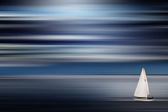 Sail Away II (Chrisnaton) Tags: blue lake sailboat sailing horizon surreal motionblur truthandillusion