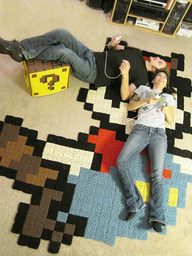 Aerial view: Raccoon Mario rug & Question Block ottoman for Nintendo Power!