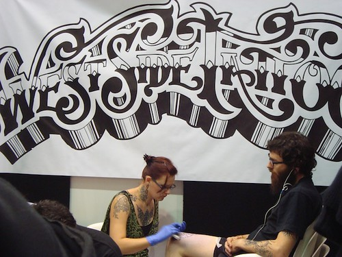 convention goers · convention floor · West Side Tattoo