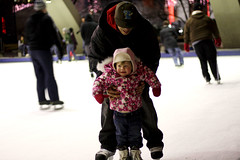 For Beginners (Julie Lavelle) Tags: camera city winter people baby toronto sports girl canon 50mm december bokeh father skating help learning 18 2009 nathanphillipssquare