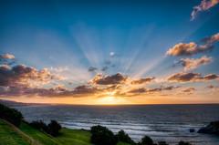 A Back Beach Sunset (Mark Solly (F-StopNinja)) Tags: blue sunset sea sky sun beach grass rays hdr clifftop newplymouth backbeach explored nikond90 tamron18270mm centenialdrive marksolly