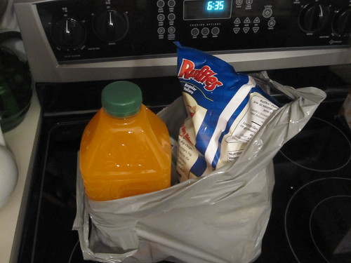 Fake orange juice, chips, 2 packs of Halls - $15.39