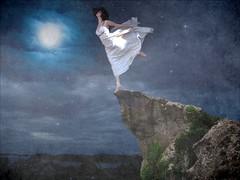 Freedom (KatB Photography) Tags: cliff woman moon female night manipulated dark model wind blowing manipulations nightsky heights skirts manipulate whitedress standingontheedge