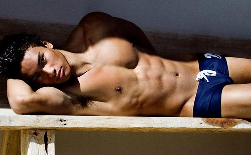 underwear male model pose so sexy shirtless laying on wooden bench furniture
