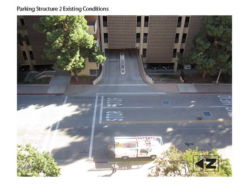 Before: The crosswalk and stop sign configuration for the primary Parking Structure 2 driveway