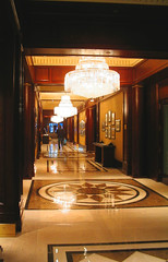 NYC 2011 071 (catchesthelight) Tags: nyc light floors hotel centralpark manhattan interior parquet historic lobby angelinajolie chandeliers celebrities artdeco renovation deco judelaw 59thst photoshop40 jumeirahessexhouse nationaltrusthistorichotelsofamerica essexhouseneonsign
