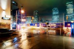 9:43pm, New York City (mudpig) Tags: nyc newyorkcity longexposure newyork reflection rain yellow skyline night geotagged construction downtown cityscape crane cab taxi worldtradecenter wtc groundzero mudpig stevekelley