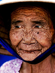 Ketsana typhoon (linh.ngan) Tags: poverty old sea portrait woman storm face lines weather contrast coast 9 vietnam relief elderly dragan wrinkle climatechange typhoon quangnam  ketsana