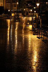 Shine on Me (Fairy_Nuff) Tags: street light wet lamp rain night canon bench eos shine 7d llandudno msh1209 wfclland2009 reallyquitealotofrain msh120917 wfcxmas09silent