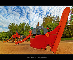 this used to be my playground [hdr] (alvin lamucho ) Tags: park old trees red orange house green broken colors playground clouds boat sand madonna slide kuwait depth hdr uwa fintas overcooked thisusedtobemyplayground fintaspark alvinlamucho