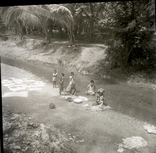 Esser with Hugo Curran in KulawiA group washing clothes in a stream