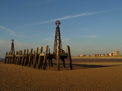 Structure on the beach (Tony Worrall) Tags: old uk blue england sky brown color beach lines metal grit outdoors golden wooden seaside sand nw pattern colours view northwest steel postcard sandy columns victorian scenic rusty structure dirty lancashire splinter shore ripples poles rotten damaged upright seashore hue crusty built abandonned relic olden wavey supports strands lancs fylde stannespier stannesonsea