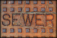 SEWER (armigeress) Tags: sign metal rust sewer