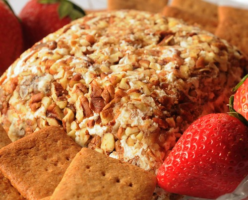 closeup Date Cheese ball-decorated with strawberries and served with homemade graham crackers