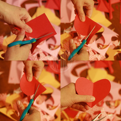 cutting a paper heart