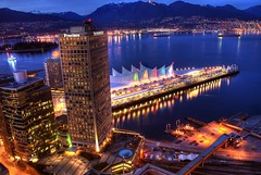 Vancouver Waterfront and the North Shore Mountains (HDR) (Brandon Godfrey) Tags: above city longexposure bridge blue winter red white mountain snow canada mountains nature yellow skyline night vancouver train reflections rockies photography lights twilight scenery downtown cityscape bc pacific northwest metro harbour britishcolumbia sony centre north tracks rocky rail railway scene canadian clear shore hour western pacificnorthwest northamerica stanleypark olympic olympics coal dslr westcoast range capped chevron lionsgate canadaplace barge hdr highdynamicrange 2010 babyblue vast lowermainland a300 landscpe theprovince photomatix tonemapped tonemapping thevancouversun thechallengegame challengegamewinner