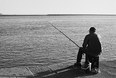 just fishing... (...storrao...) Tags: blackandwhite bw film portugal rio 35mm river pier fishing fisherman olympus pb porto douro filme pretoebranco foz encontro pescador rolo rivermouth pescando penft olympuspenft onfilm convertedtobw molhe portografia storrao sofiatorro