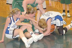 Hannah Buermann (left) and Brooke Nyman battle for the loose ball in Crane�s win over Adrian. (Photo by DEBBIE RANEY)